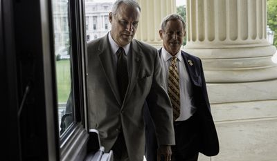 FILE – This May 30, 2014, file photo shows House Veterans' Affairs Committee Chairman Rep. Jeff Miller, R-Fla., left, and Rep. Joe Wilson, R-S.C., right, arriving for a vote on Capitol Hill in Washington as Veterans Affairs Secretary Eric Shinseki was resigning over the VA health care scandal.  (AP Photo/J. Scott Applewhite, File)