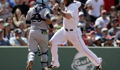 Boston Red Sox's Jonny Gomes, right, scores on a sacrifice fly as Tampa Bay Rays catcher Jose Molina, left, is unable to make the play in the fourth inning of a baseball game, Sunday, June 1, 2014, in Boston. (AP Photo/Steven Senne)