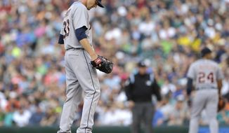 Detroit Tigers starting pitcher Drew Smyly pauses on the mound in the second inning of a baseball game against the Seattle Mariners, Saturday, May 31, 2014, in Seattle. Smyly was pulled after giving up three runs, all of them earned, in four innings. (AP Photo/Ted S. Warren)