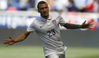 United States' Fabian Johnson celebrates after scoring a goal against Turkey in the first half of an international friendly soccer match on Sunday, June 1, 2014, in Harrison, N.J. (AP Photo/Julio Cortez)