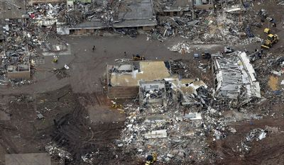 This May 21, 2013 file photo shows an aerial view of Plaza Towers Elementary School which was damaged during a May 20, 2013 tornado, in Moore, Oklahoma. For the second time since a tornado ravaged Moore, killing 24 people including seven students at Plaza Towers Elementary School, organizers plan to circulate an initiative petition calling for a statewide vote to fund the construction of school storm shelters. (AP Photo/Tony Gutierrez, File)