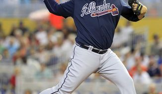 Atlanta Braves starting pitcher Aaron Harang throws against the Miami Marlins in the first inning during their baseball game in Miami, Sunday, June 1, 2014. (AP Photo/Joe Skipper)