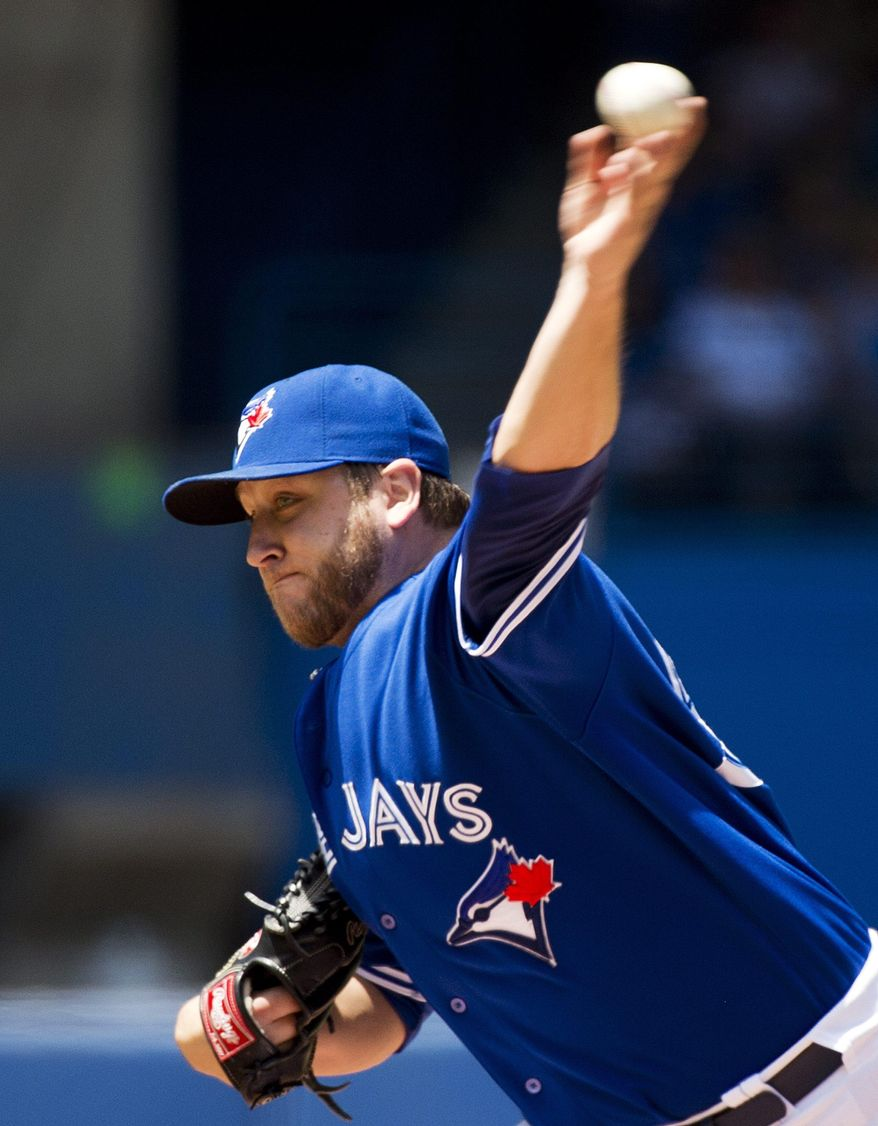 Toronto Blue Jays starting pitcher Mark Buehrle works against the Kansas City Royals during the first inning of a baseball game in Toronto on Sunday, June 1, 2014. (AP Photo/The Canadian Press, Nathan Denette)