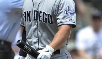 San Diego Padres' Yonder Alonso reacts to striking out during the fifth inning of an inter league baseball game against the Chicago White Sox in Chicago, Sunday, June 1, 2014. Chicago won 4-1. (AP Photo/Paul Beaty)
