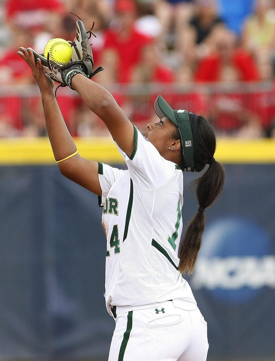 Baylor second baseman Ari Hawkins catches a Florida ball during the third inning of an an NCAA women's softball College World Series tournament game, Sunday, June 1, 2014, in Oklahoma City. (AP Photo/Alonzo Adams)