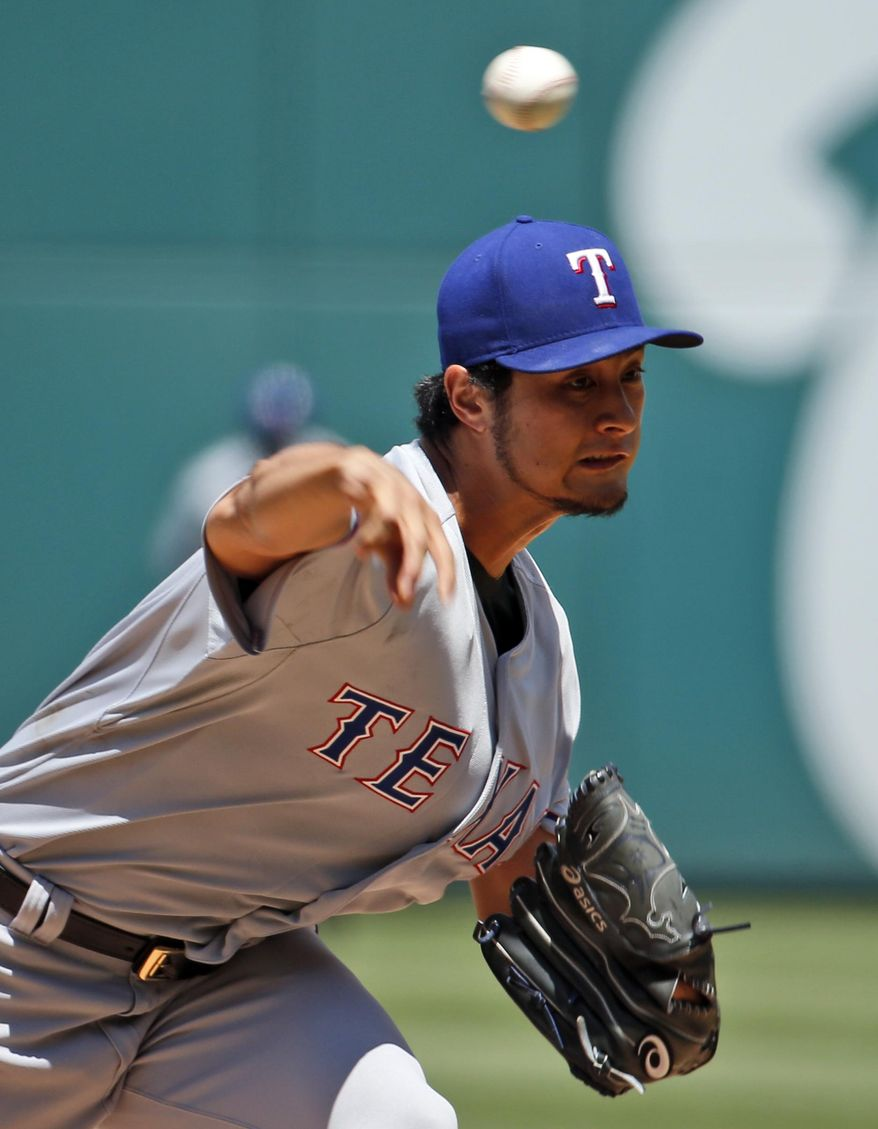 Texas Rangers starting pitcher Yu Darvish (11) throws during the second inning of a baseball game against the Washington Nationals at Nationals Park, Sunday, June 1, 2014, in Washington. (AP Photo/Alex Brandon)