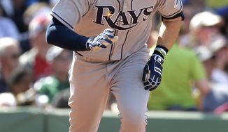 Tampa Bay Rays' Evan Longoria advances after hitting a single off a pitch by Boston Red Sox's Jon Lester in the sixth inning of a baseball game, Sunday, June 1, 2014, in Boston. The Red Sox won 4-0. (AP Photo/Steven Senne)