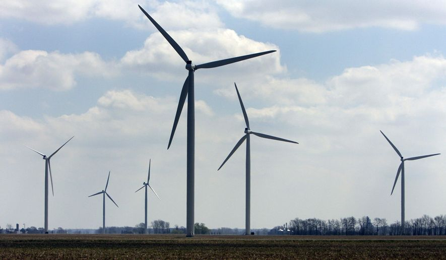 FILE-- This April 21, 2008, file photo shows wind turbines at the Harvest Wind Farm in Oliver Township, Mich. State officials say Michigan is positioned to require more of its electricity to come from wind and other renewable sources. Existing law sets a 10 percent target that must be met in 2015. Michigan officials will assess the impact on the state when President Barack Obama on Monday, June 2, 2014, announces tougher new air quality standards affecting coal-fired power plants. Coal produces about 55 percent of the electricity in the state while natural gas produces 11 percent. (AP Photo/Al Goldis, File)