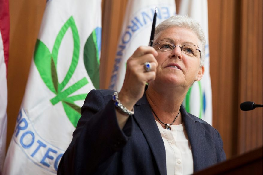 Environmental Protection Agency Administrator Gina McCarthy prepares to sign a plan to cut carbon emissions from power plants. (Associated Press)