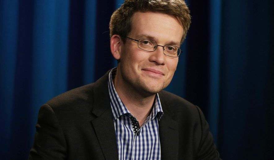 "John Green, author of ""The Fault in Our Stars,"" poses during an interview in New York on Monday, June 2, 2014. The book has been adapted into a feature film starring Shailene Woodley and Ansel Elgort. (AP Photo/Richard Drew)"