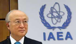 Director General of the International Atomic Energy Agency, IAEA, Yukiya Amano of Japan waits for the start of the IAEA board of governors meeting at the International Center in Vienna, Austria, Monday, June 2, 2014. (AP Photo/Ronald Zak)