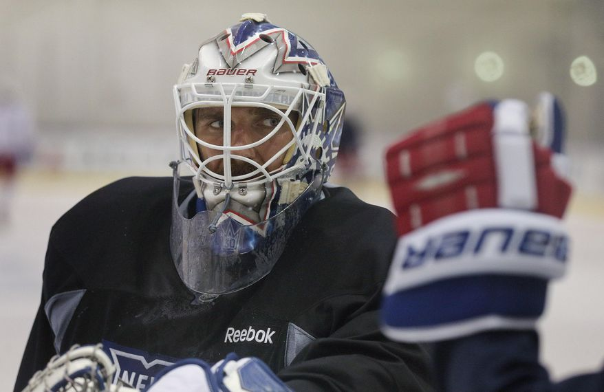 New York Rangers goalie Henrik Lundqvist listens for instructions during a drill at practice, Monday, June 2, 2014, in Greenburgh, N.Y. The Rangers will face the Los Angeles Kings in Game 1 of Stanley Cup Final in Los Angeles on Wednesday. (AP Photo/Julie Jacobson)