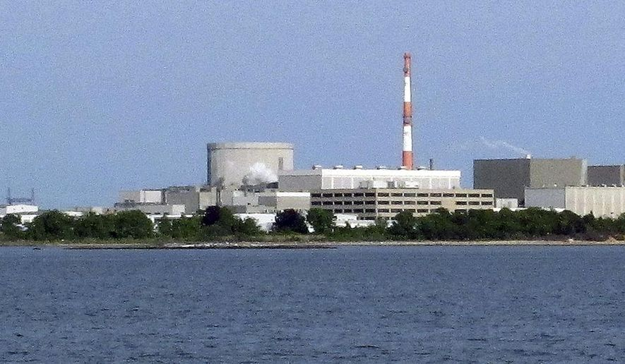 In this Sunday, June 1, 2014 photo, the Millstone Power Station nuclear power complex in Waterford, Conn., is seen from the shore in East Lyme, Conn. Federal regulators began inspecting the plant on Monday, June 2, 2014, more than a week after a power failure forced both units to shut down and water was found to be slightly radioactive. (AP Photo/Dave Collins)