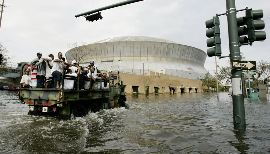 National Guard trucks haul residents through floodwaters to the Superdome after Hurricane Katrina hit  in New Orleans, Tuesday, Aug. 30,  2005. Officials called for a mandatory evacuation of the city, but many residents remained in the city. (AP Photo/Eric Gay)