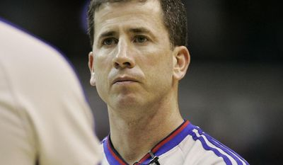 ** FILE ** NBA official Tim Donaghy talks with another official during a timeout during a Washington Wizards New Jersey Nets basketball game, Tuesday, April 10, 2007 in Washington. The NBA acknowledged Friday the FBI is investigating Tim Donaghy for betting on games, including ones in which he officiated. (AP Photo/Haraz N. Ghanbari, file)