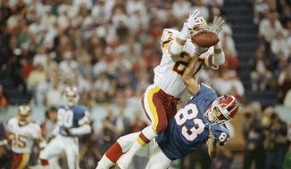 Washington Redskins Brad Edwards battles Buffalo Bills Andre Reed (83) for the ball during 2nd quarter Super Bowl  XXVI football action at the Metrodome in Minneapolis, on Sunday, Jan. 26, 1992. (AP Photo/John Gaps)