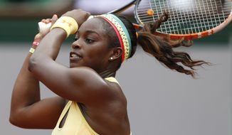 Sloane Stephens of the U.S.  returns the ball during the fourth round match of the French Open tennis tournament against Romania's Simona Halep at the Roland Garros stadium, in Paris, France, Monday, June 2, 2014. Halep won in two sets 6-4, 6-3. (AP Photo/Darko Vojinovic)