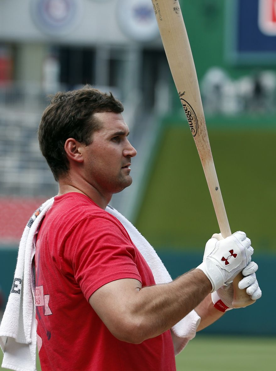 Washington Nationals third baseman Ryan Zimmerman holds a bat during batting practice before a baseball game against the Miami Marlins at Nationals Park Wednesday, May 28, 2014, in Washington. Zimmerman is on the disabled list with a broken thumb, and was recently cleared to swing a bat. (AP Photo/Alex Brandon)