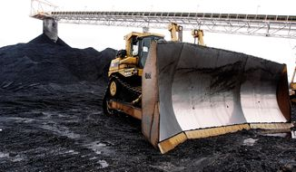 In this March 9, 2006 file photo, a large dozer sit ready for work at Peabody Energy's Gateway Coal Mine near Coulterville, Ill. A 10 percent reduction in carbon dioxide emissions will mean a decline of 180 million tons, or 18 percent, in U.S. coal production, according to Bernstein Research. That would hurt miners such as Peabody Energy, Alpha Natural Resources and Arch Coal. (AP Photo/Seth Perlman, File)