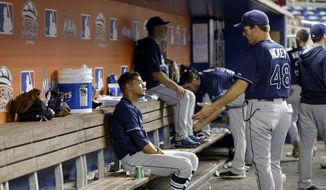 Tampa Bay Rays starting pitcher Chris Archer, left, talks with pitching coach Jim Hickey (48) during the fourth inning of an interleague baseball game against the Miami Marlins, Tuesday, June 3, 2014, in Miami. (AP Photo/Lynne Sladky)