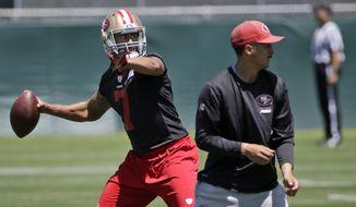 San Francisco 49ers quarterback Colin Kaepernick throws during an NFL football organized team activity, Tuesday, June 3, 2014, in Santa Clara, Calif. (AP Photo/Marcio Jose Sanchez)