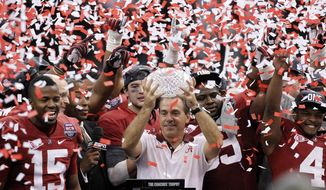 FILE - In this Jan. 9, 2012 file photo, Alabama head football coach Nick Saban celebrates with his team after the BCS National Championship college football game against LSU  in New Orleans. Saban's new contract _ expected to be in the $7 million range _ is set to be formally considered by the board of trustees. The trustees will also vote on deals for 10 of his assistants, including new offensive coordinator Lane Kiffin. (AP Photo/Gerald Herbert, File)