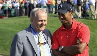FILe - In this June 3, 2012 file photo, Jack Nicklaus, left, talks with Tiger Woods after Woods won the Memorial golf tournament at the Muirfield Village Golf Club in Dublin, Ohio. Nicklaus was in his customary spot behind the 18th green at Muirfield Village, waiting on the winner _ or in this case, the survivor. Given the meltdowns by top players, this year without Tiger Woods has shown that it's really hard to win or that Woods was really good at it.  (AP Photo/Tony Dejak, File) **FILE**