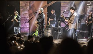 The country music group Alabama playing in Nashville's historic Ryman Auditorium. (AP)