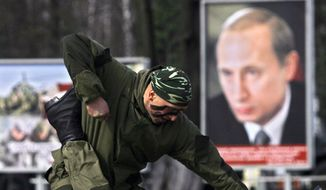 Russian Interior Ministry troopers give a training exhibition during a celebration of 197th anniversary of creation of Interior Ministry Forces in Ashukino, Russia, Thursday, March 27, 2008.  (AP Photo/Sergey Ponomarev)
