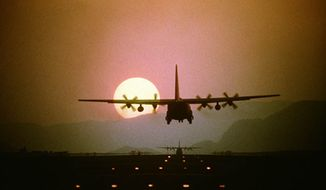 ** FILE ** A C-130 Hercules aircraft prepares to land. (U.S. Air Force)