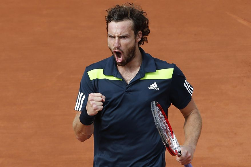 Latvia's Ernests Gulbis clenches his fist after scoring a point during the quarterfinal match of the French Open tennis tournament against Tomas Berdych of the Czech Republic at the Roland Garros stadium, in Paris, France, Tuesday, June 3, 2014.  (AP Photo/Darko Vojinovic)