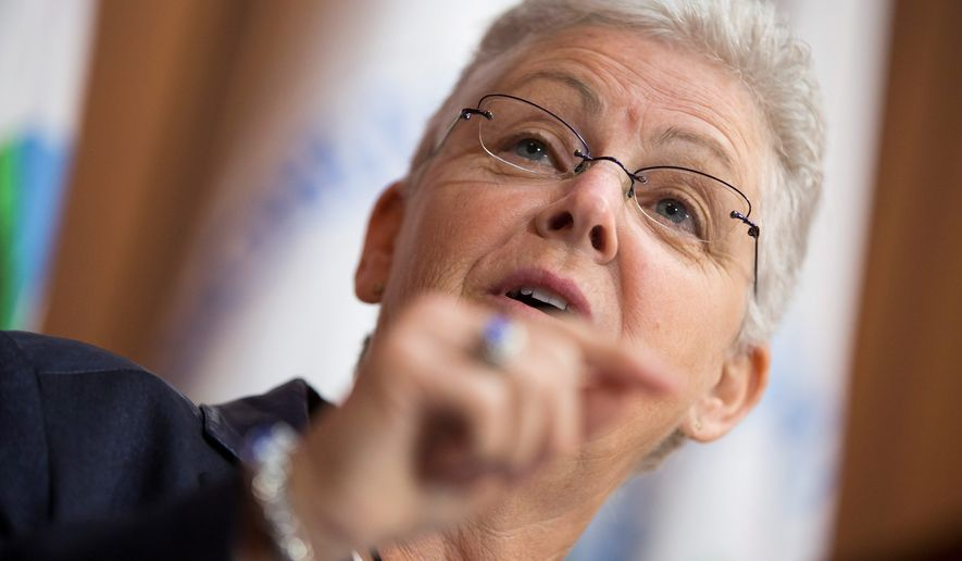 Gina McCarthy, Environmental Protection Agency administrator, speaks June 2, 2014, at agency headquarters in Washington during an announcement of a plan to cut carbon dioxide emissions from power plants by 30 percent by 2030. In a sweeping initiative to curb pollutants blamed for global warming, the Obama administration unveiled a plan that cuts carbon dioxide emissions from power plants by nearly a third over the next 15 years, but pushes the deadline for some states to comply until long after President Obama leaves office. (Associated Press)