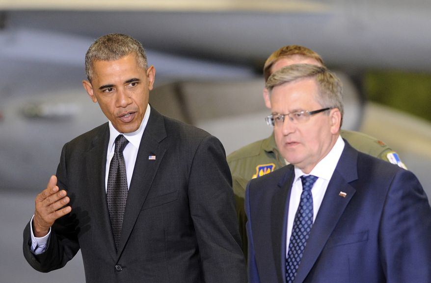 U.S. President Barack Obama, left, and Polish President Bronislaw Komorowski walk for a meeting with Polish and U.S. soldiers at the military airport in Warsaw, Poland, Tuesday, June 3, 2014. Obama came to Poland to meet regional leaders and attend ceremonies marking 25 years of Poland's democracy. (AP Photo/Alik Keplicz)