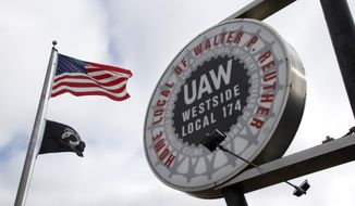 FILE - This March 22, 2013 file photo shows the United Auto Workers Local 174 sign outside their building in Romulus, Mich. Delegates to the United Auto Workers convention on Tuesday, June 3, 2014 voted to raise dues 25 percent to shore up the union's finances, the first increase in 47 years. (AP Photo/Paul Sancya, File)