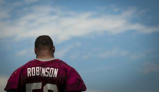 Washington Redskins linebacker Keenan Robinson (52) talks to reporters following drills during an OTA at Redskins park in Ashburn, Va., Wednesday, June 4, 20124. (Photo Rod Lamkey Jr.)