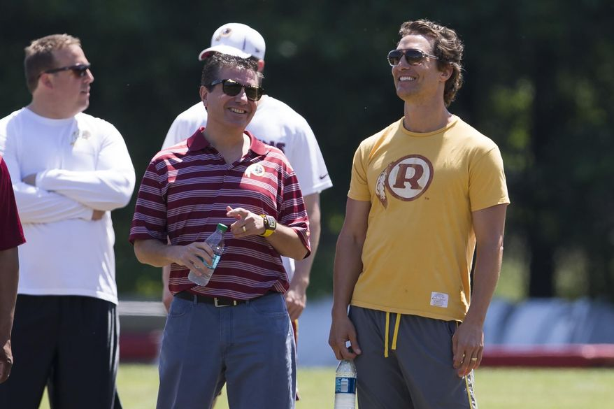 Actor Matthew McConaughey, right, stands with Washington Redskins owner Daniel Snyder during NFL football practice at Redskins Park, on Wednesday, June 4, 2014, in Ashburn, Va. (AP Photo/ Evan Vucci)