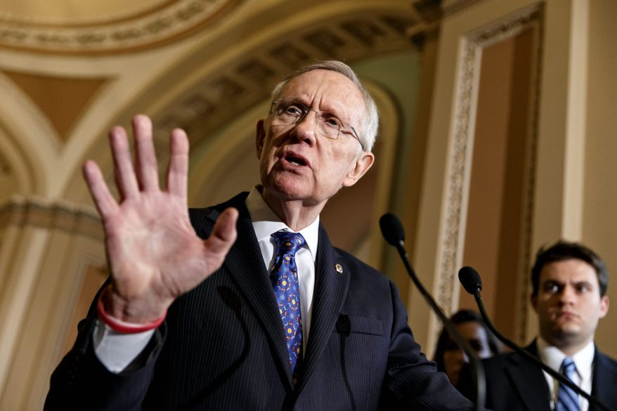 **FILE** Senate Majority Leader Harry Reid declined the Washington Redskins' offer to attend a game unless the team changes its nickname. (Associated Press)