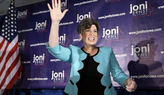 ** FILE ** State Sen. Joni Ernst waves to supporters at a primary election night rally after winning the Republican nomination for the U.S. Senate, Tuesday, June 3, 2014, in Des Moines, Iowa. The 43-year-old Ernst won the nomination over five candidates. (AP Photo/Charlie Neibergall)