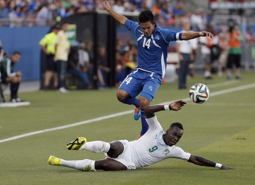 Ivory Coast midfielder Cheik Ismael Tiote (9) defends against El Salvador forward Andres Flores (14) during the first half of a friendly soccer match leading up to the World Cup, Wednesday, June 4, 2014, in Frisco, Texas. (AP Photo/Brandon Wade)