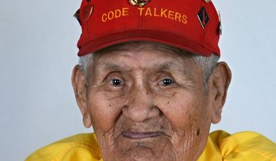 FILE - In this May 17, 2011 file photo, Navajo Code Talker Chester Nez poses at his home in Albuquerque. Nez, the last of the 29 Navajos who developed an unbreakable code that helped win World War II, died Wednesday morning, June 4, 2014, of kidney failure at his home in Albuquerque. He was 93. Nez was in the 10th grade when a Marine recruiter went to the Navajo reservation looking for young men who were fluent in Navajo and English. Nez told The Associated Press in a 2010 interview that he kept the decision to enlist a secret from his family and lied about his age. (AP Photo/Albuquerque Journal, Dean Hanson, File)