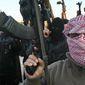 ** FILE ** Al Qaeda gunmen gather in the streets of Fallujah, Iraq, Jan. 2014. (Associated Press)