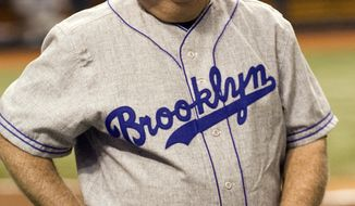 """Tampa Bay Devil Rays coach Don Zimmer, and member of the 1955 world champion Brooklyn Dodgers, smiles during a pre-game tribute to Zimmer before a """"Turn Back the Clock""""  interleague baseball game against the Los Angeles Dodgers Saturday, June 23, 2007 in St. Petersburg, Fla. Los Angeles players wore the uniforms from the Brooklyn team and Tampa Bay players wore uniforms from the St. Petersburg Saints of the Florida State League. (AP Photo/Steve Nesius)"""