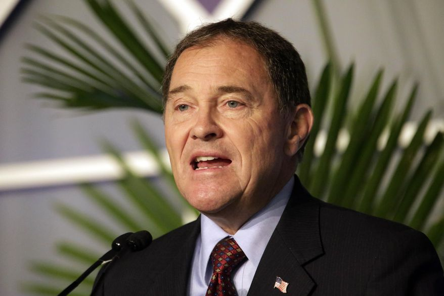 Utah Gov. Gary Herbert speaks during the third-annual Energy Development Summit Wednesday, June 4, 2014, in Salt Lake City. Herbert says President Barack Obama's new plan to cut pollution discharged by America's power plants over the next two decades will likely raise electricity rates for consumers and cost the state jobs.  (AP Photo/Rick Bowmer)