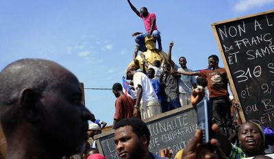 Members of the Muslim community demonstrate, calling for the disarmament of Anti Balaka factions and for peace in the PK5 district of Bangui, Central African Republic, Saturday May 31, 2014.  (AP Photo/Jerome Delay)    FRANCE OUT