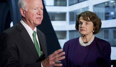 Senate Intelligence Committee Chair Sen. Dianne Feinstein, D-Calif., listens at right as the committee's Vice Chairman Sen. Saxby Chambliss, R-Ga., speaks on Capitol Hill in Washington, Tuesday, June 3, 2014, following a closed-door committee briefing.  (AP Photo/Manuel Balce Ceneta)