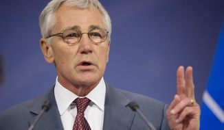 U.S. Defense Secretary Chuck Hagel speaks during his news conference at the conclusion of a meeting of the North Atlantic Council (NATO) in Brussels, Wednesday, June 4, 2014. NATO defense ministers gathered for the first time since the Ukraine crisis, and top of the agenda was how to react long-term to Russia's new military capabilities and its willingness to use them. (AP Photo/Pablo Martinez Monsivais, Pool)