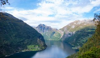 """FILE - This undated file photo provided by the tour company Adventures by Disney shows a Norwegian fjord that is part of an itinerary based on the movie """"Frozen."""" The film's fantasy kingdom of Arendelle was based on Norway's Geirangerfjord. The movie's popularity has spilled over into demand for """"Frozen""""-related merchandise, trips and visits with """"Frozen"""" characters at Disney parks. (AP Photo/Adventures by Disney)"""
