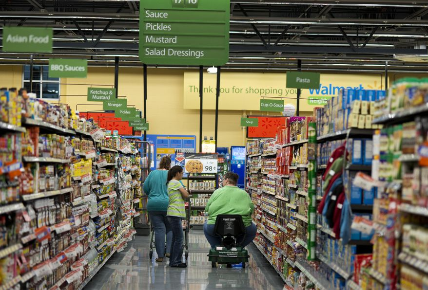 Customers shop at Wal-Mart Neighborhood Market in Bentonville, Ark., Thursday, June 5, 2014. (AP Photo/Sarah Bentham) ** FILE **
