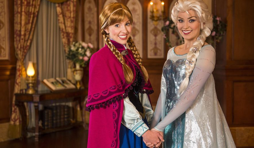 "This undated image released by Disney shows Disney characters Anna, left, and her sister Elsa from the animated film ""Frozen"" at Princess Fairytale Hall at Walt Disney World Resort in Lake Buena Vista, Fla. Princess Fairytale Hall features walls of stone and stained glass windows, a spacious gallery adorned with portraits of Disney princesses and elegantly finished rooms where guests can meet Anna & Elsa, Cinderella, Rapunzel and other princesses. Wait times to meet the sisters stretches for hours and reservations are snapped up as soon as they become available, part of a frenzy for all things ""Frozen.""  (AP Photo/Disney, Matt Stroshane)"