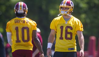 Washington Redskins quarterback Colt McCoy (16) joins quarterback Robert Griffin III (10) on the practice field during an OTA at Redskins park in Ashburn, Va., Wednesday, June 4, 20124. (Photo Rod Lamkey Jr.)